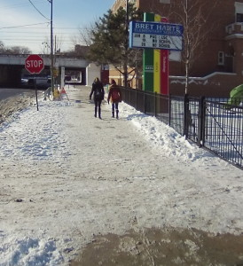 Snow has been only partially cleared from the sidewalk at Bret Harte Elementary.