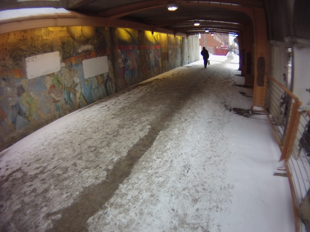 A path has been trampled through the blown snow along 55th St. under the Metra Electric.